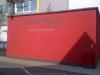 Fassadenbeschriftung mit Putzdekor