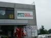 Firmenschild aus Aluverbundplatte mit Folienplots
